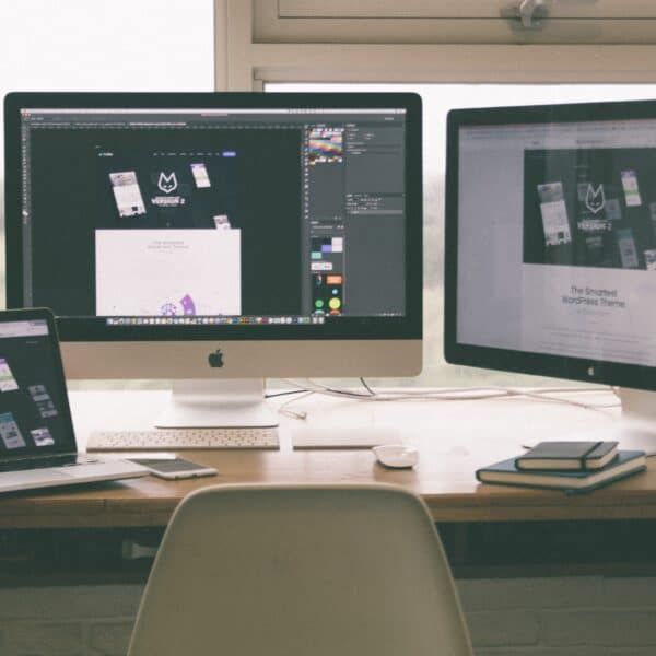 Three screens with website design tools